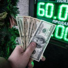 Slūgstant nerimui dėl prekybos, brangsta JAV doleris