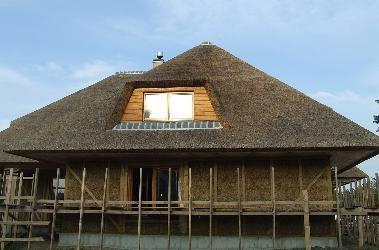 Norintiems saugoti klimatą - ekskursija po šiaudinius namus