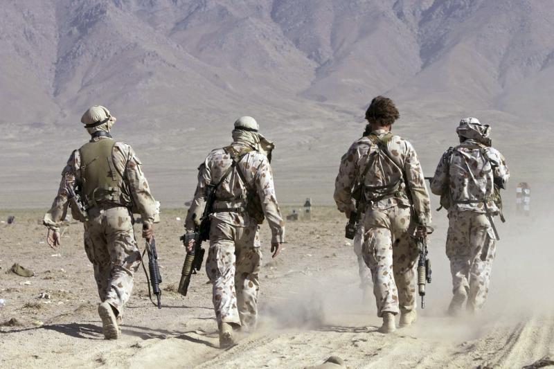 JAV kariai Afganistane pozuodavo su sudraskytais sprogdintojų kūnais