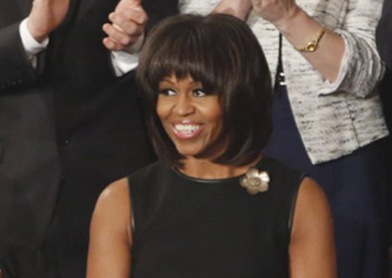 M. Obama: naują šukuoseną įkvėpė amžiaus vidurio krizė