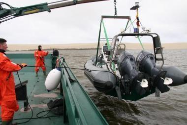 Išgelbėti per audrą Kuršių mariose plaukę žvejai