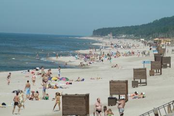 Praplatėję Palangos paplūdimiai laukia poilsiautojų