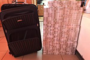 Vilnietis lagaminuose į Lenkiją vežė kalną kontrabandinių cigarečių