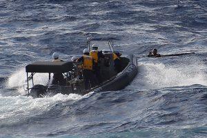 Dėl paleistos granatos kilęs gaisras laive nusinešė trijų kinų gyvybę