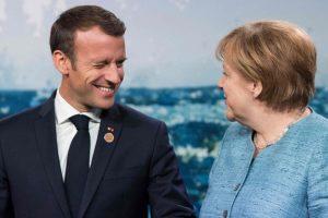 Nesutarimai dėl migrantų temdys E. Macrono ir A. Merkel derybas dėl ES ateities