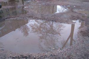 Uostamiesčio kiemai prašosi asfalto