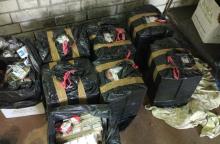 Kontrabandinį rūkalų krovinį baltarusiai slėpė garažėlyje Vilniuje